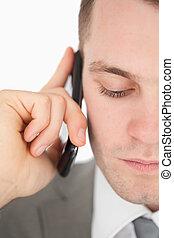 Close up of a sad businessman making a phone call