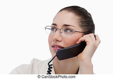 Close up of a secretary making a phone call