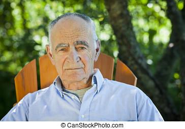 Close-up of a senior man looking at the camera