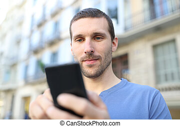 Close up of a serious adult man using smart phone