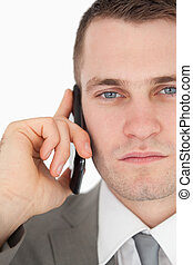 Close up of a serious businessman making a phone call