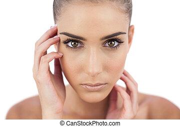 Close up of a serious woman looking at camera