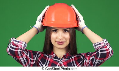 Close up of a sexy beautiful female constructionist smiling...