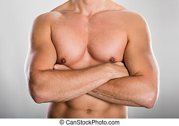 Man With Muscular Build - Close-up Of A Shirtless Man With...