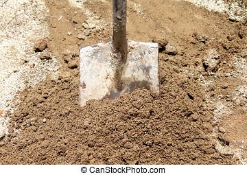 shovel in sand