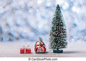 Close-up of a small toy car standing near a Christmas tree