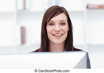 Close-up of a smiling businesswoman at work