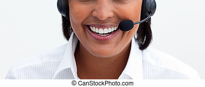 Close-up of a smiling businesswoman with headset on