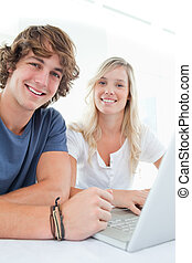 Close up of a smiling couple looking at the camera