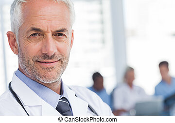 Close up of a smiling doctor