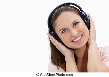 Close-up of a smiling girl wearing headphones