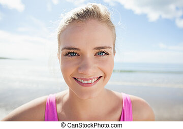 Close up of a smiling woman on beach