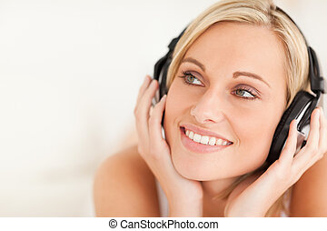 Close up of a smiling woman wearing headphones