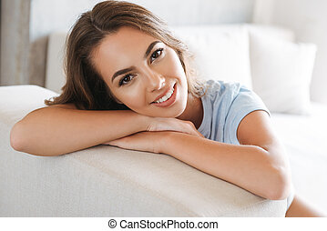 Close up of a smiling young woman relaxing