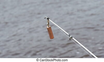 Close-up of a spinning rod of fisherman's on the background...