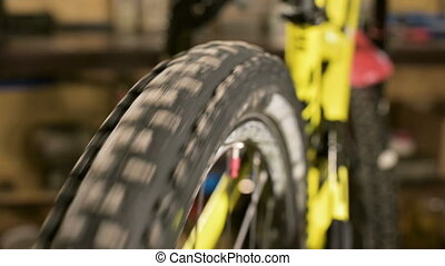 Close-up of a spinning wheel of a mountain sports bike in a...