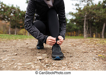Close up of a sportsgirl tying her shoelace