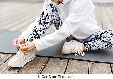 Close up of a sportswoman tying shoelace
