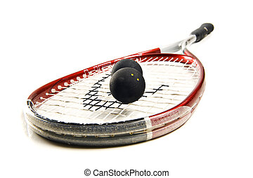 Close up of a squash racket and balls on white