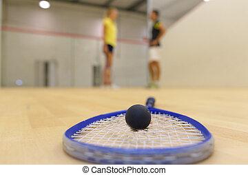 close up of a squash racket