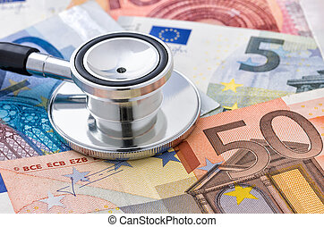 Close-up of a stethoscope on euro bills