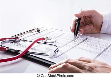 Close-up Of A Stethoscope On White Desk