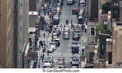 close up of a street scene in new york, shot from a roof with an extreme zoom lens
