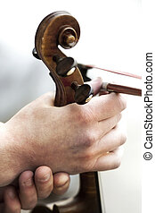 Close up of a string musical instrument holding a hand