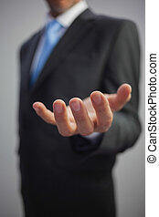 Close up of a stylish businessman reaching out