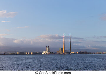Close up of a sunlit Poolbeg power station
