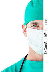 Close-up of a surgeon wearing a surgical mask isolated on a...