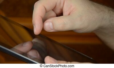 Close-up of a tablet in hands