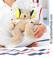 Close-up of a teddy bear with headphones on