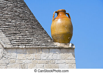 Close up of a terracotta water jug. Alberobello. Apulia.