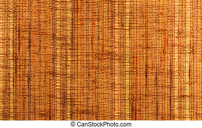 Close-up of a textile surface with orange and brown color