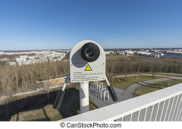 close up of a tower viewer looking over the skyline of Berlin Marzahn