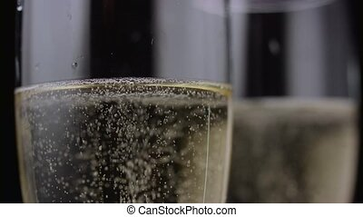 Close up of a two glass of champagne. Black background