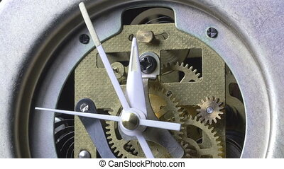 Close-up of a vintage clock running
