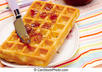 Close-up of a waffle and knife