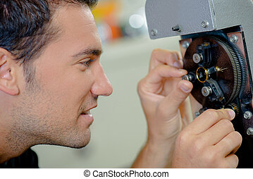close up of a watchmaker at work