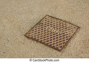 water utility - close-up of a water utility drain cover