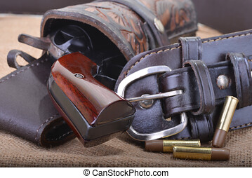 Close up of a western six shooter revolver with Gun Belt, holster and bullets