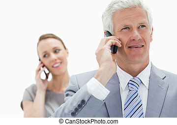 Close-up of a white hair businessman talking on the phone...
