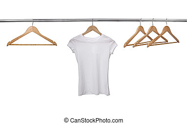 white t shirt on cloth hangers - close up of a white t shirt...