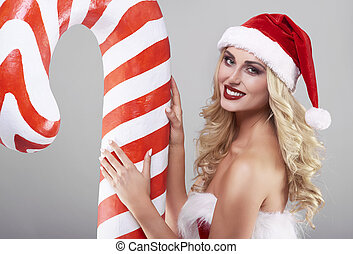 Close up of a woman and a candy cane