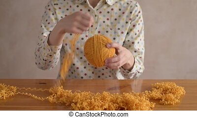 Close up of a woman clewing yarn up