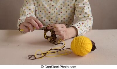 Close up of a woman crocheting