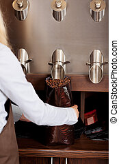 woman filling coffee beans in a bag