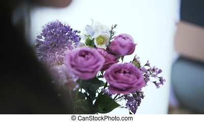 Close up of a woman florist arranging a bouquet of beautiful flowers
