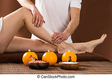 Woman Getting Her Leg Waxed